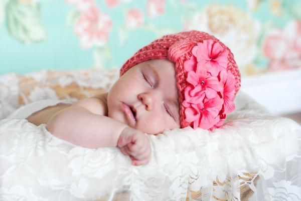 Tiny turban hat in candy pink with candy pink flowers at Pink Baby Boutique