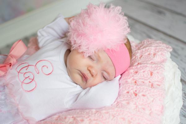 Pink soft headband embellished with a small baby pink marabou puff
